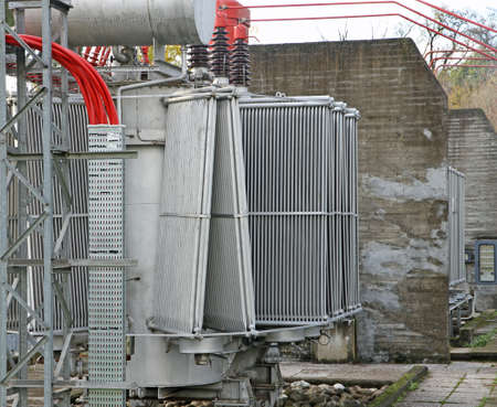 disconnecting: huge electric voltage transformer of a powerful power plant Stock Photo