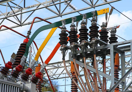 powerhouse: electrical connection with large copper bars of a high voltage transformer in a power plant to produce electricity