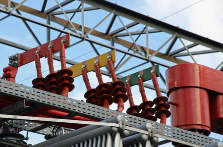 isolator high voltage: copper bars of power of a transformer at a power plant to produce electricity