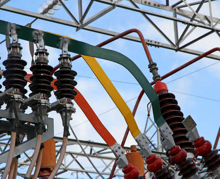 powerhouse: electrical connection with copper bars of a very  high voltage transformer in a power plant to produce electricity