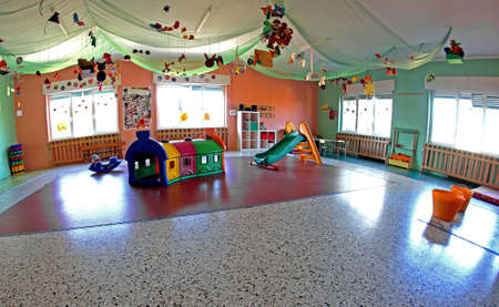 spacious lounge important nursery center with many Christmas ornaments and decorations and many games for children photo