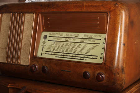 sports programme: ancient Italian superheterodyne radio transistor of the middle of the last century in Burr walnut and the stations names