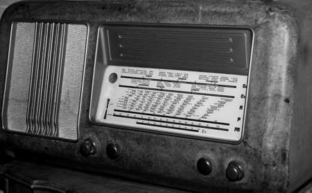 sports programme: vintage radio of the last century with the knobs to adjust the radio channels and radio stations names Stock Photo