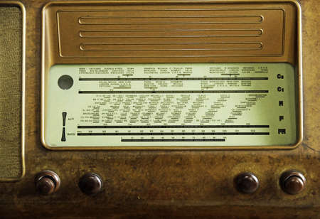 sports programme: vintage radio of the last century with the knobs to adjust the radio channels