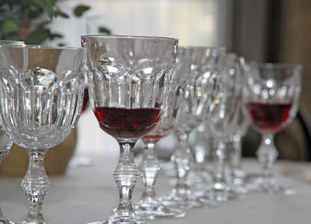 elegant Bohemian crystal glasses lined up in set table for the bridal party photo