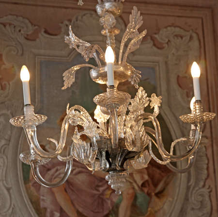 expensive crystal chandelier made with murano glass on the ceiling of a villa photo