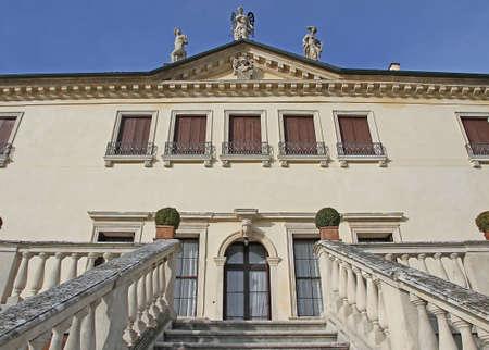 imposing stone steps leading to the entrance of the prestigious Venetian villa