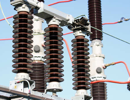Electrical insulators inside a high-voltage power station Stock Photo