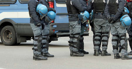 truncheon: policemen with bullet-proof jacket and blue helmet during the revolt in the city
