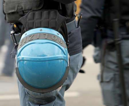 policewomen: Italian police helmet blue ready to be worn during a demonstration in the big Italian city Stock Photo