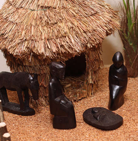 presepio: Nativity set in an African village with wooden figurines 2