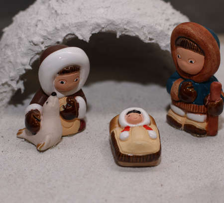 presepio: cold igloo with the crib in Eskimo of North Pole version and a seal Stock Photo