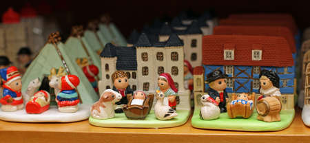 presepio: many Nativity scenes from around the world in religious goods store 2