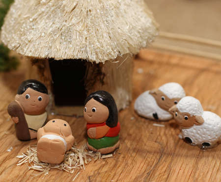 nativity set: small miniature Nativity set with the white sheep and the Holy Family Stock Photo