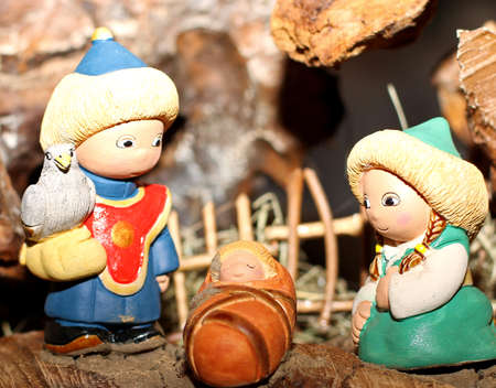 presepio: crib in an Asian village with people with traditional Asian clothes 1