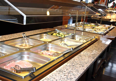 self service: steel tray filled with food inside the self service
