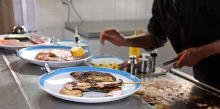 restaurant kitchen during the preparation of vegetable dishes photo