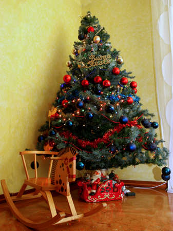 nines: Christmas tree decorated to the nines with a wooden rocking horse
