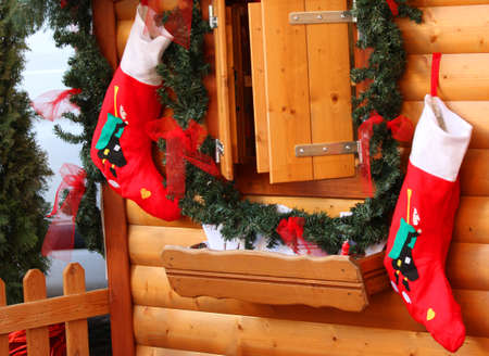 The stockings of the befana in wooden wall hanging waiting for Epiphany