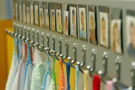 hooks with colorful towels of nursery children photo