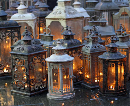 historical lantern with candle lit in vintage style for decorating places of worship and prayer photo