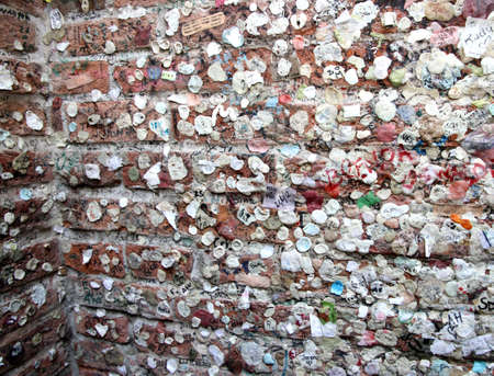 romeo and juliet: chewing gum wall of love on the wall of the House of Romeo and Juliet in verona