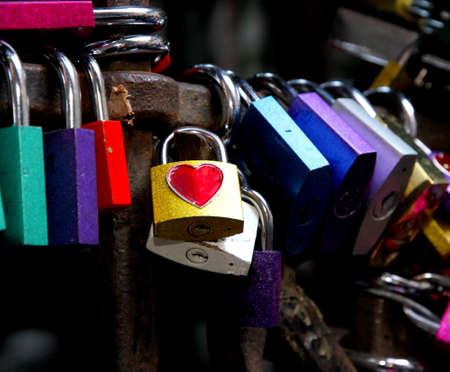 many colored locks of love in the gate of the House of Romeo and Juliet in Italy photo