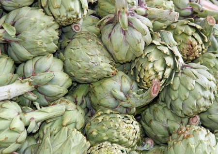 fresh artichokes for sale at vegetable market 9 photo