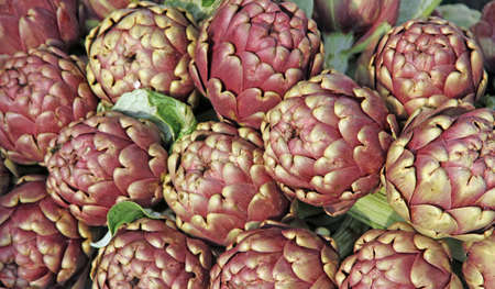 Green artichokes for sale at vegetable market 10 photo