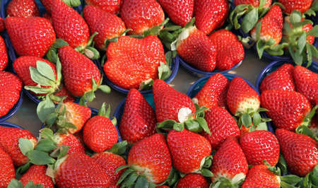 grocery store series: red ripe strawberry cups for sale at vegetable market Stock Photo