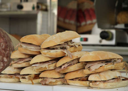 tasty sandwiches with pork for sale at the bar Stock Photo