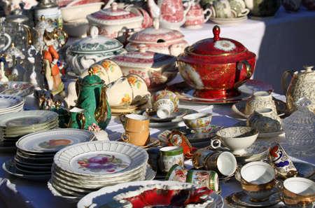 furnishings: precious antique furnishings and retro ceramic plates for sale vintage shop Stock Photo