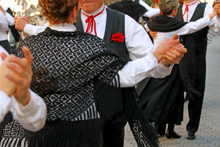 ballad: men and women dancing during the dance event in the Centre of the village