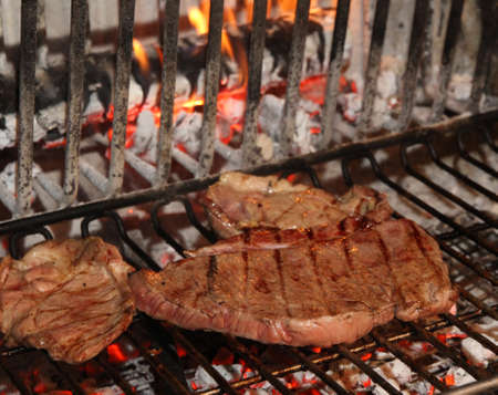 restaurateur: tasty and flavorful beef steaks cottain a fireplace of agritourism in Tuscany
