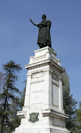 virgil: imposing statue of the famous poet Virgil in the Center in the city of Mantua in Italy Stock Photo