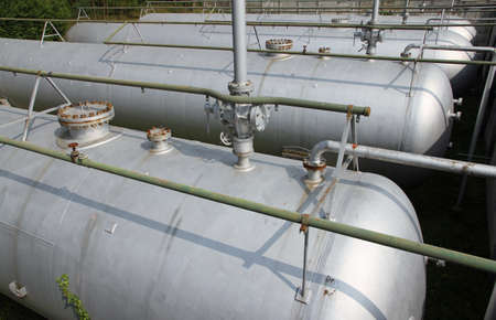 benzene: gray giant tanks and cistern the storage of gas and liquids Stock Photo