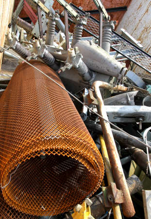 hazardous waste: old net and other rusted iron material in a container of a hazardous waste landfill