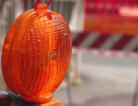 roadworks: lit red lamp for the roadworks as distress signal