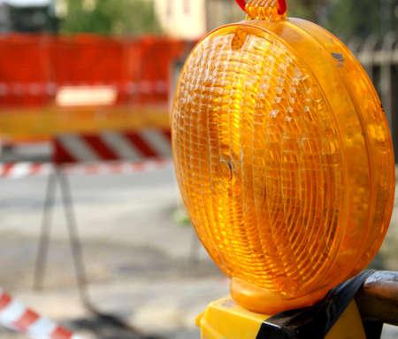 roadworks: Orange lit the lamp for the roadworks during work in progress Stock Photo