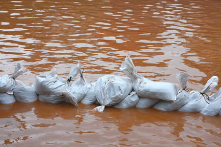 sandbag: pile of sandbags in defense from the water during the flood