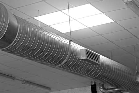 indoors: large metal tube for the air-conditioning of a large industrial complex
