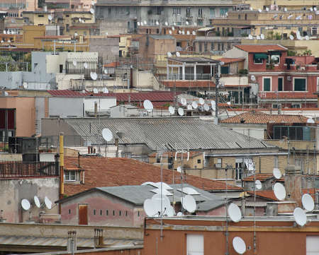 parable: roofs of the metropolis with lots of antennas and antenna for reception of television signals Stock Photo