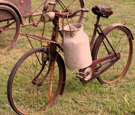 antiquity: old bikes of ancient milkman with aluminium drum