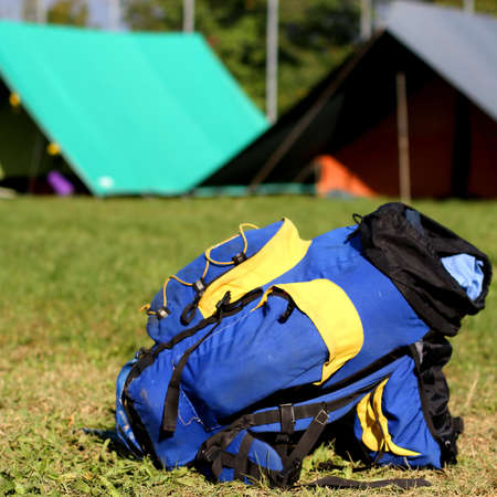 indispensable: one backpack and the tents in the campsite Stock Photo