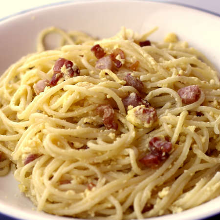 yellow spaghetti carbonara with Bacon egg and Parmesan photo