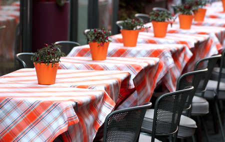 typical tables laid with checkered tablecloth for a stylish Italian restaurant in Venice photo