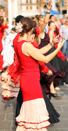 flamenco dancers expert and Spanish dance with costumes photo