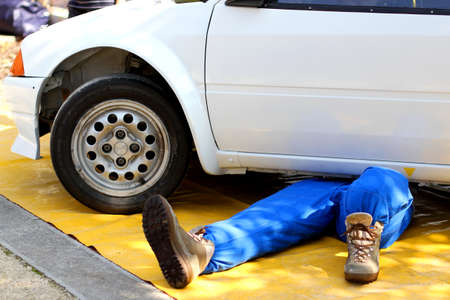 maintainer: mechanic with the suit from work while repairing the engine failure