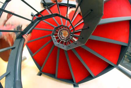 vertigo: vertigo spiral staircase with red carpet Stock Photo
