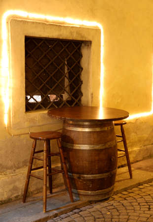 repurpose: table of a bar made from an upside-down in a small barrel of a small medieval village